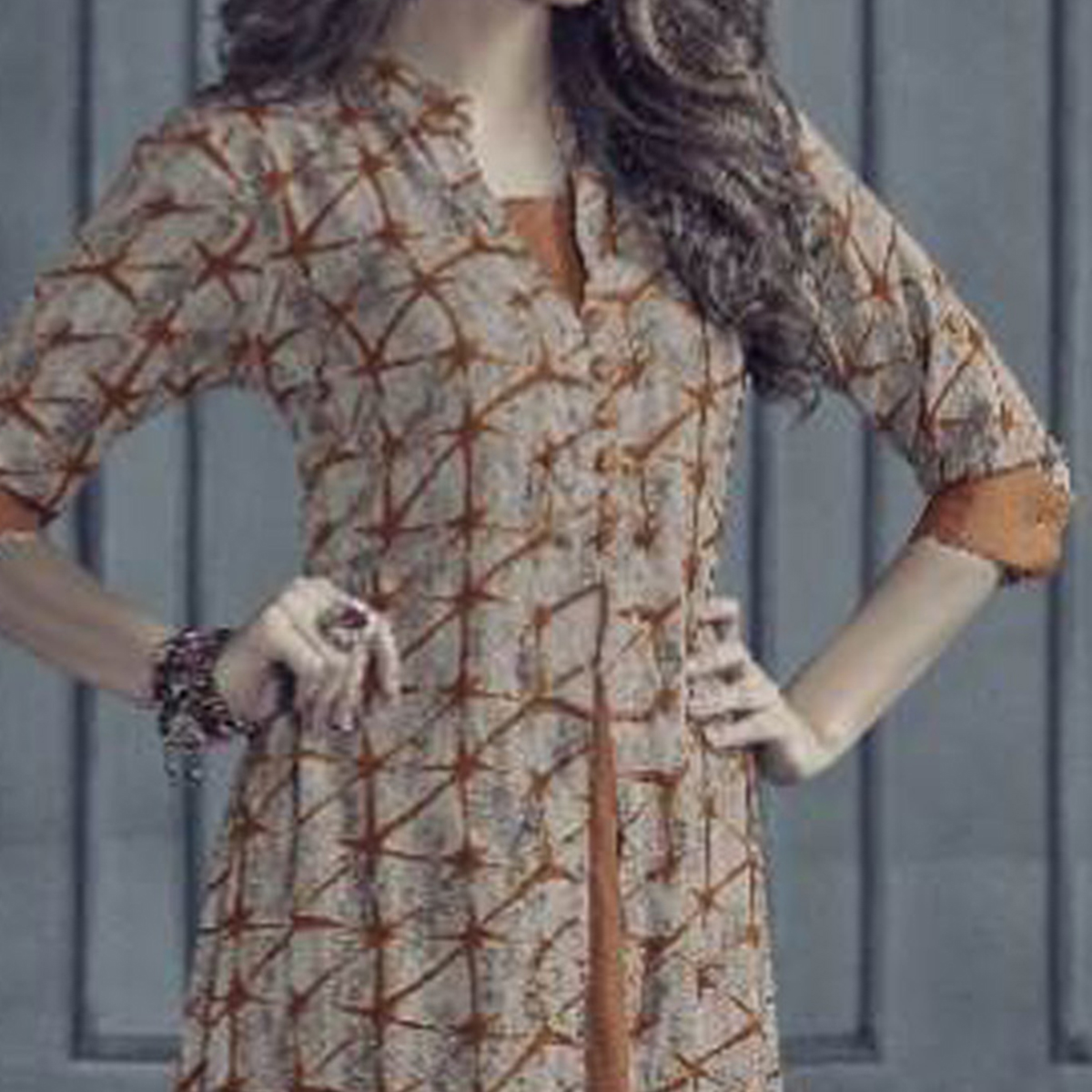 Dazzling Beige-Orange Colored Designer Printed Rayon Kurti