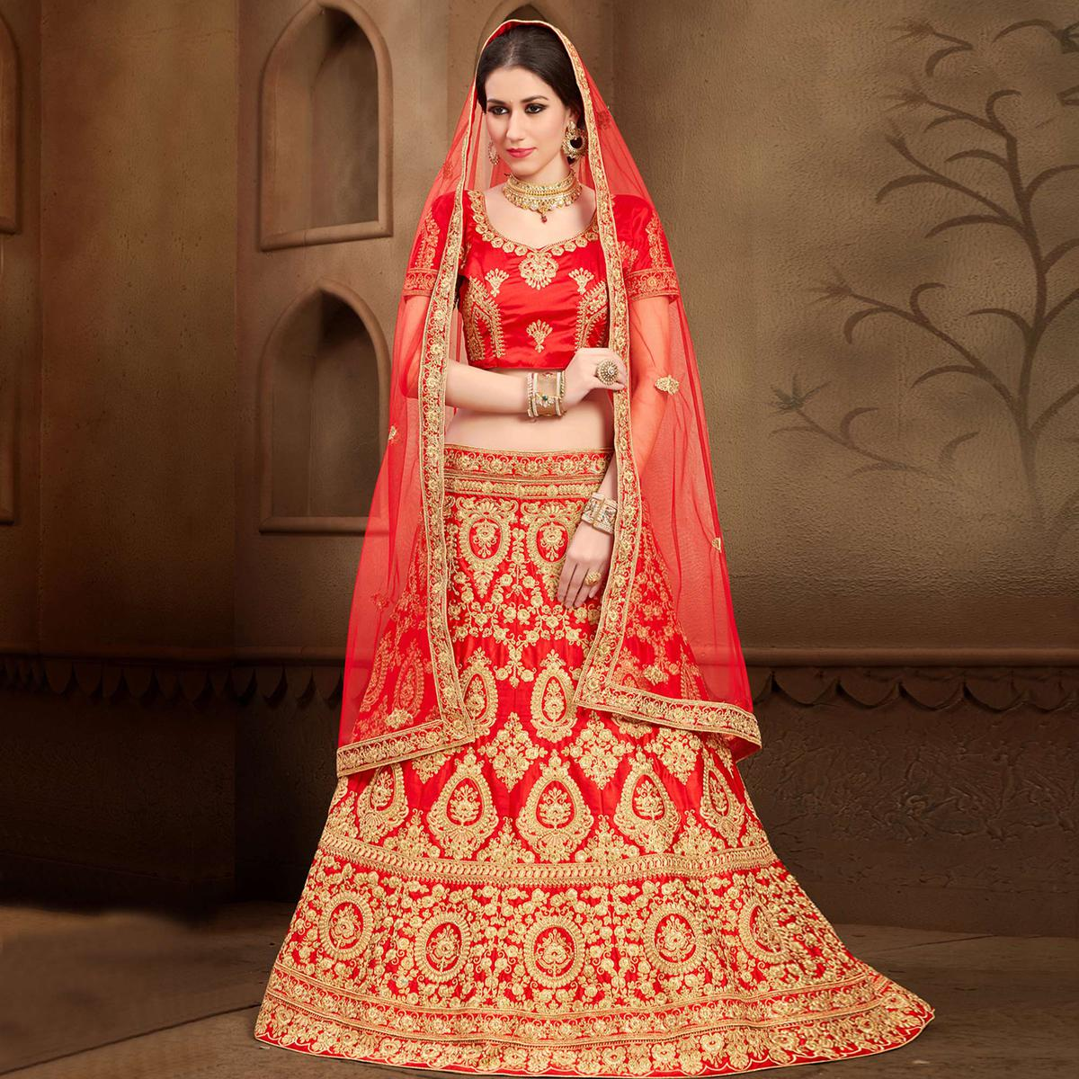 Breathtaking Red Colored Designer Heavy Embroidered Wedding Wear Art Silk Lehenga Choli