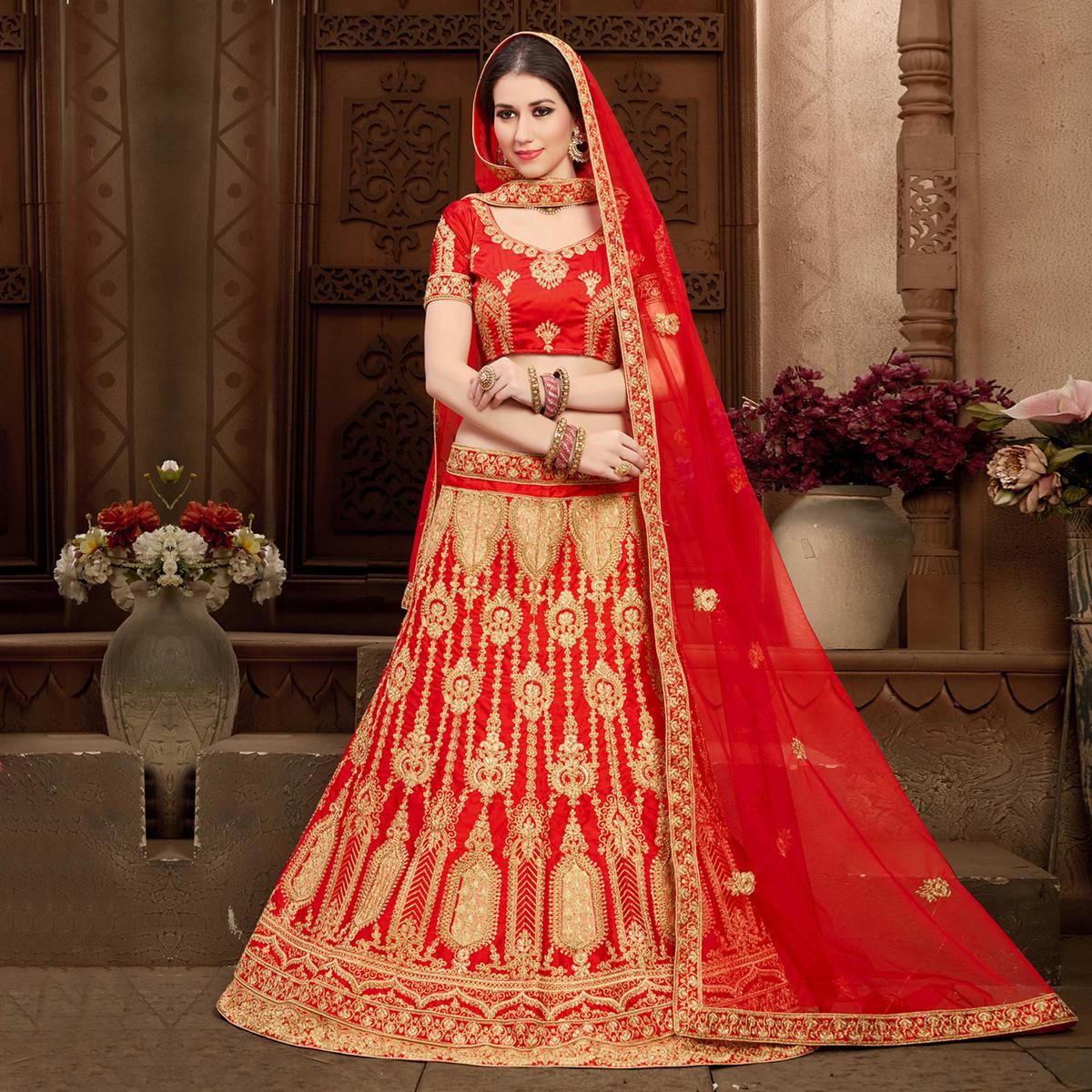 Gleaming Red Colored Designer Heavy Embroidered Wedding Wear Art Silk Lehenga Choli