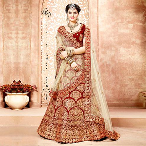 Glorious Maroon Colored Designer Heavy Embroidered Wedding Wear Velvet Lehenga Choli