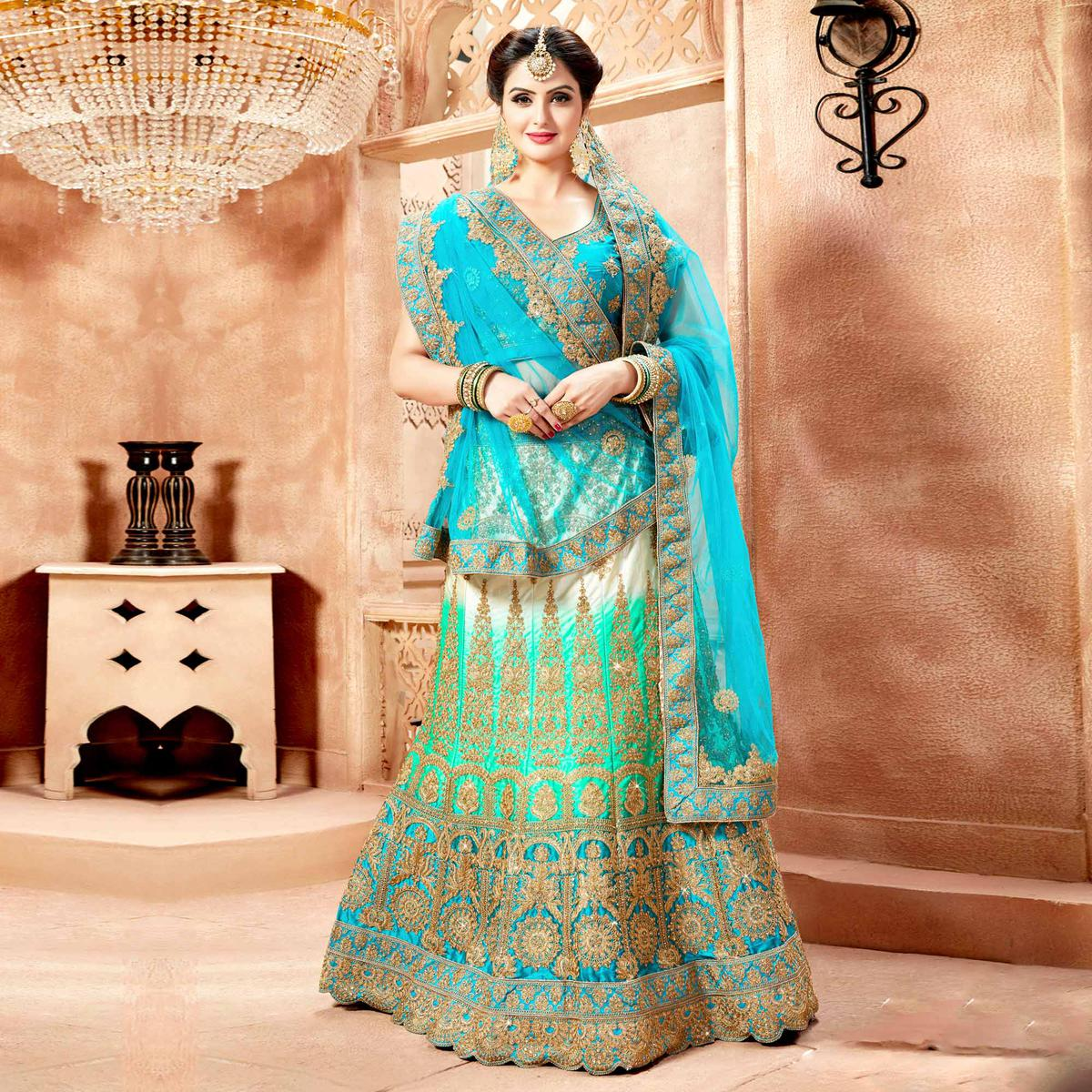 Gorgeous Turquoise Blue Colored Designer Heavy Embroidered Wedding Wear Nylon Satin Lehenga Choli