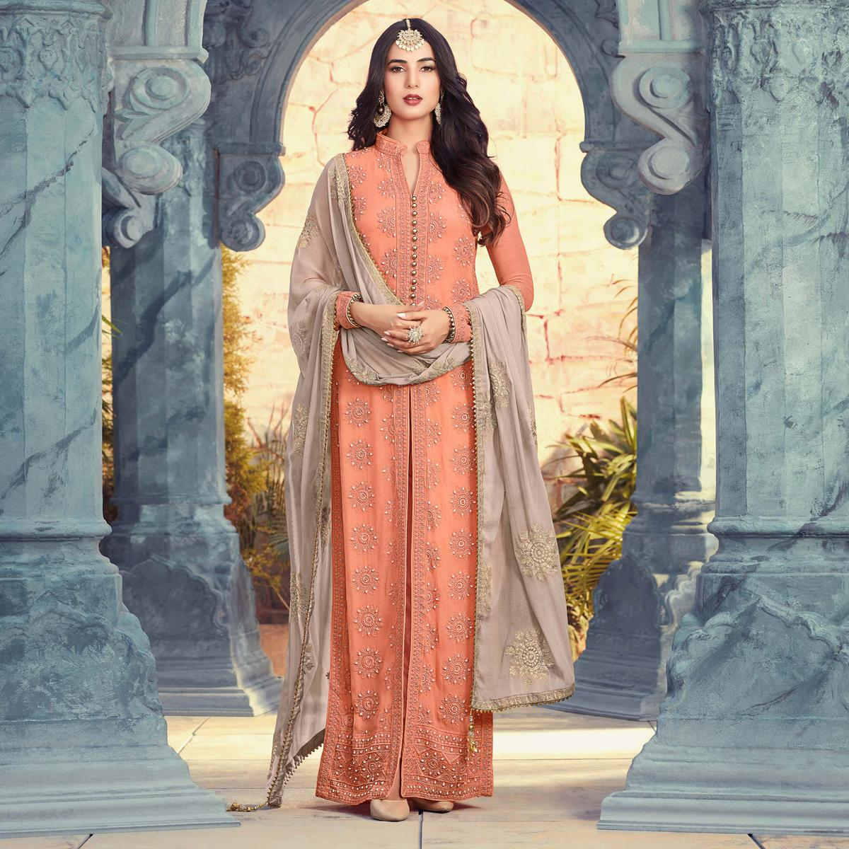 Mesmerising Peach Orange Colored Designer Embroidered Party Wear Heavy Georgette Suit