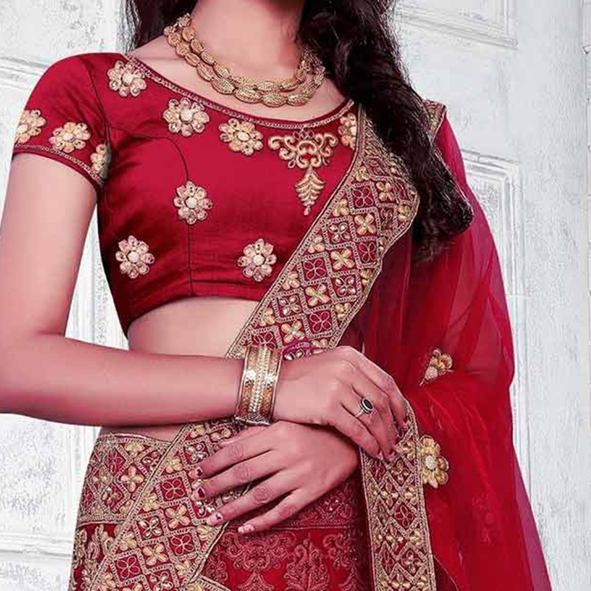 Demanding Maroon Colored Partywear Embroidered Net Lehenga Choli