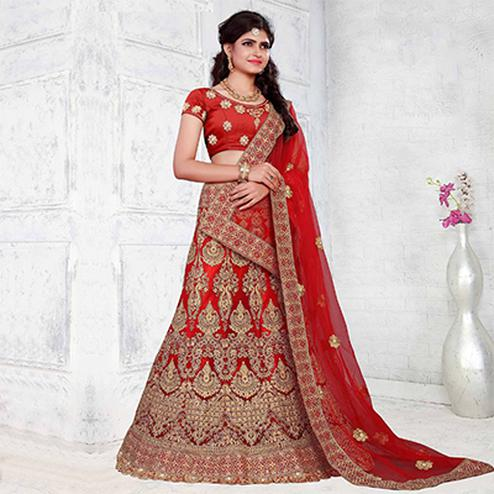 Glowing Red Colored Partywear Embroidered Net Lehenga Choli