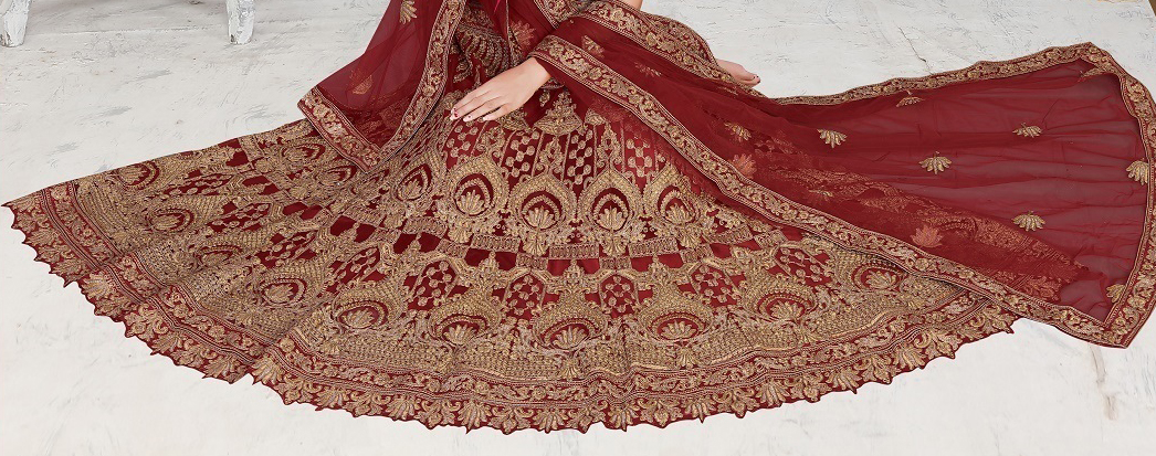 Mesmerising Maroon Colored Partywear Embroidered Net Lehenga Choli