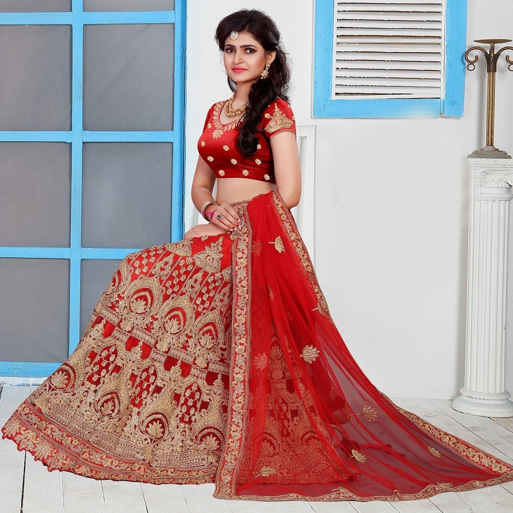 Traditional Red Colored Partywear Embroidered Net Lehenga Choli