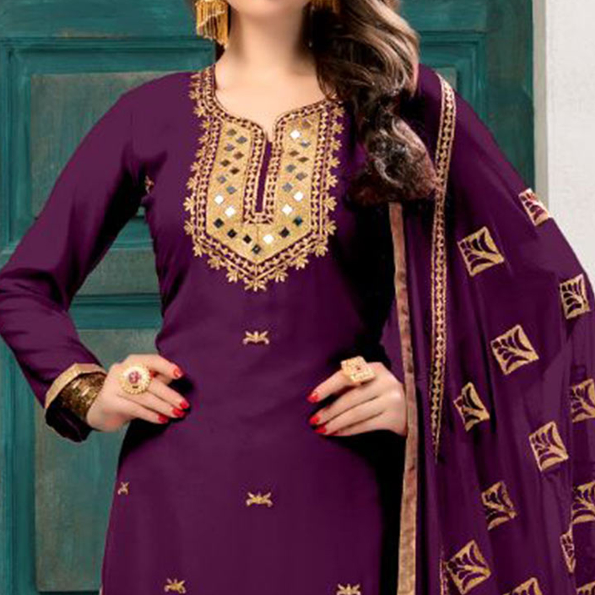 Elegant Purple Colored Partywear Embroidered Georgette Suit