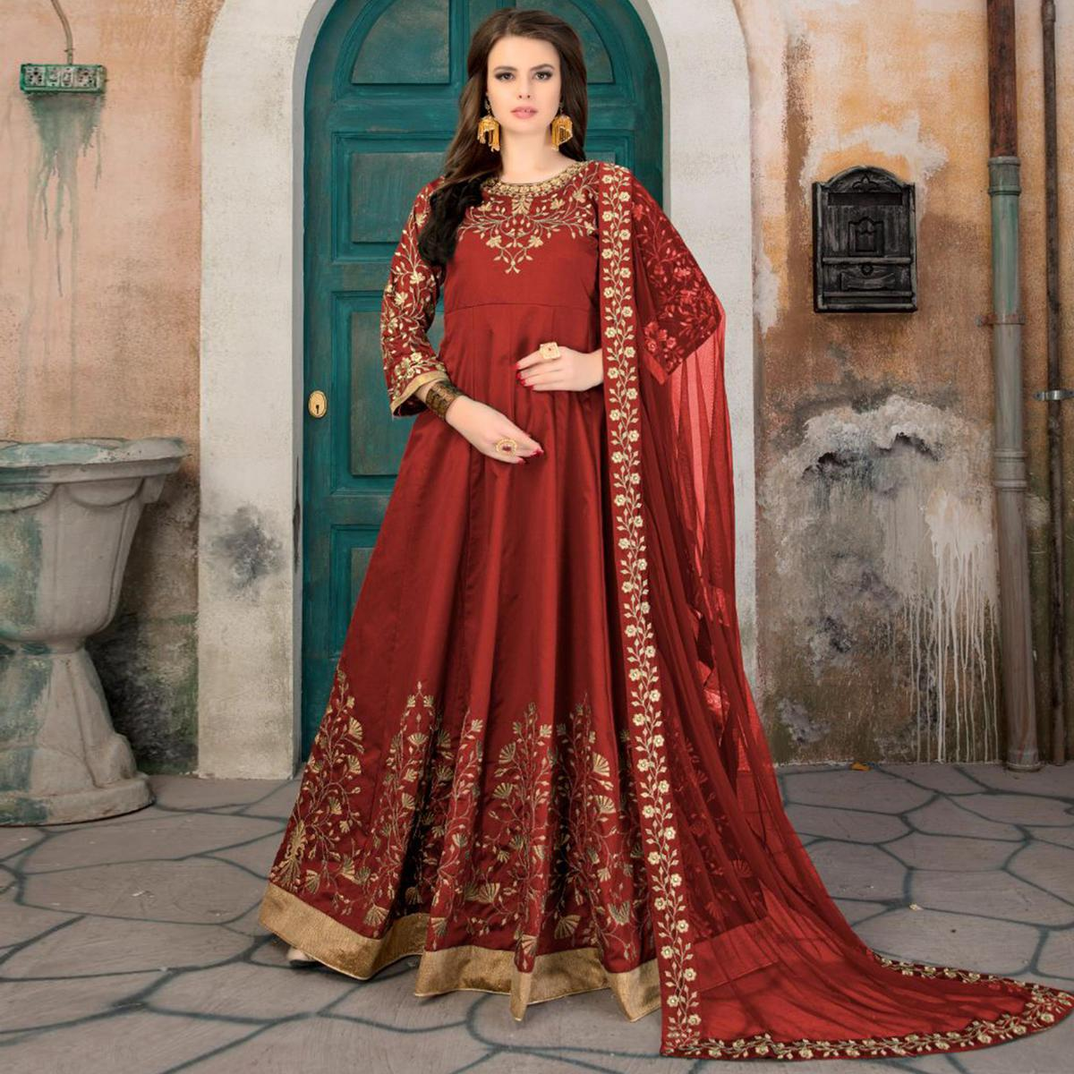 Trendy Red Colored Partywear Embroidered Tapeta Silk Anarkali Suit