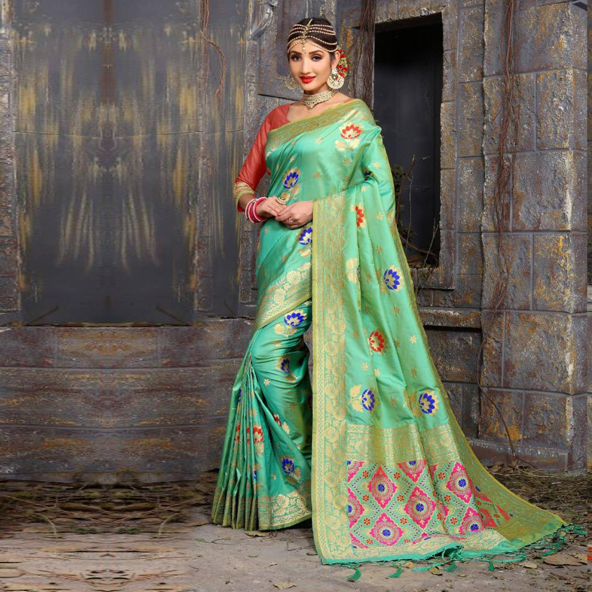 Glorious Sea Green Colored Traditional Wear Heavy Art Silk Saree
