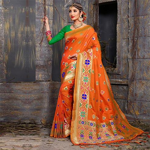 Pretty Orange Colored Traditional Wear Heavy Art Silk Saree