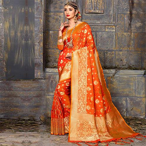 Adorning Orange Colored Traditional Wear Heavy Art Silk Saree
