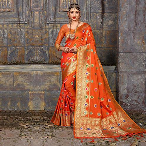 Snazzy Orange Colored Traditional Wear Heavy Art Silk Saree