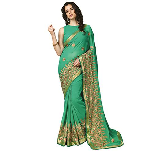 Eye-Catching Turquoise Green Colored Partywear Embroidered Georgette Saree