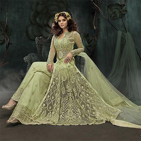 Pleasant Pista Green Colored Designer Wedding Wear Net Palazzo Suit