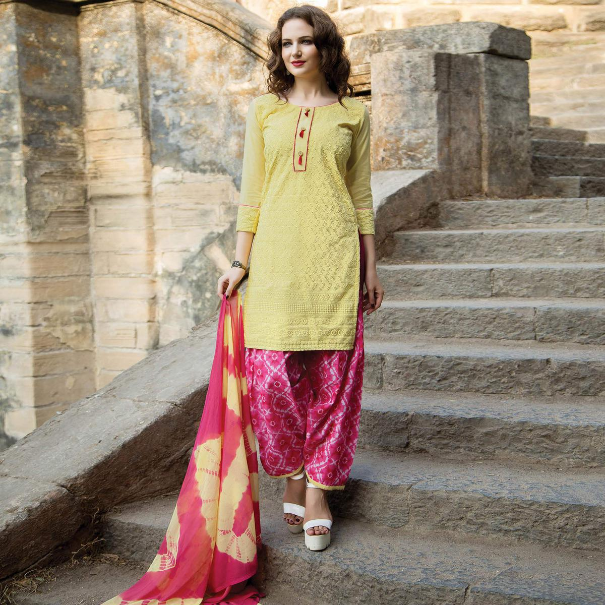 Attractive Yellow Colored Casual Printed Cotton Salwar Suit