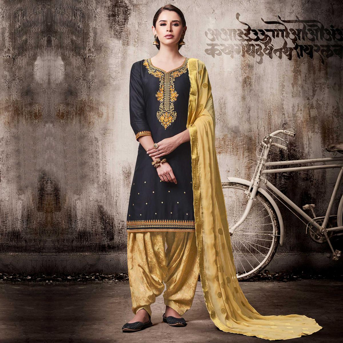 Classy Black Colored Embroidered Work Party Wear Silk Cotton Patiala Suit