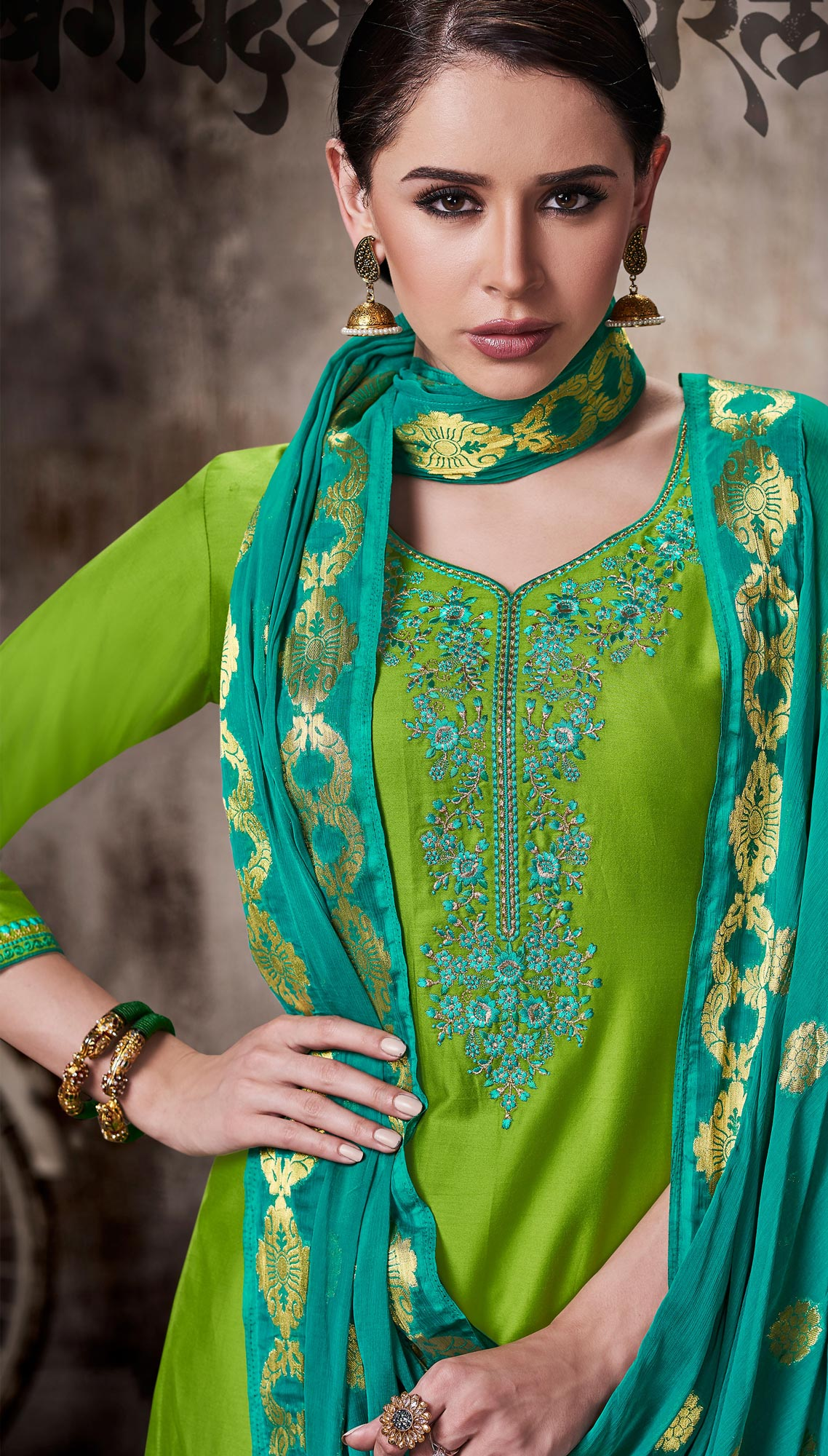 Gorgeous Green Colored Embroidered Work Party Wear Silk Cotton Patiala Suit