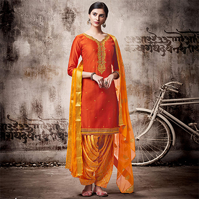 Graceful Orange Colored Embroidered Work Party Wear Silk Cotton Patiala Suit