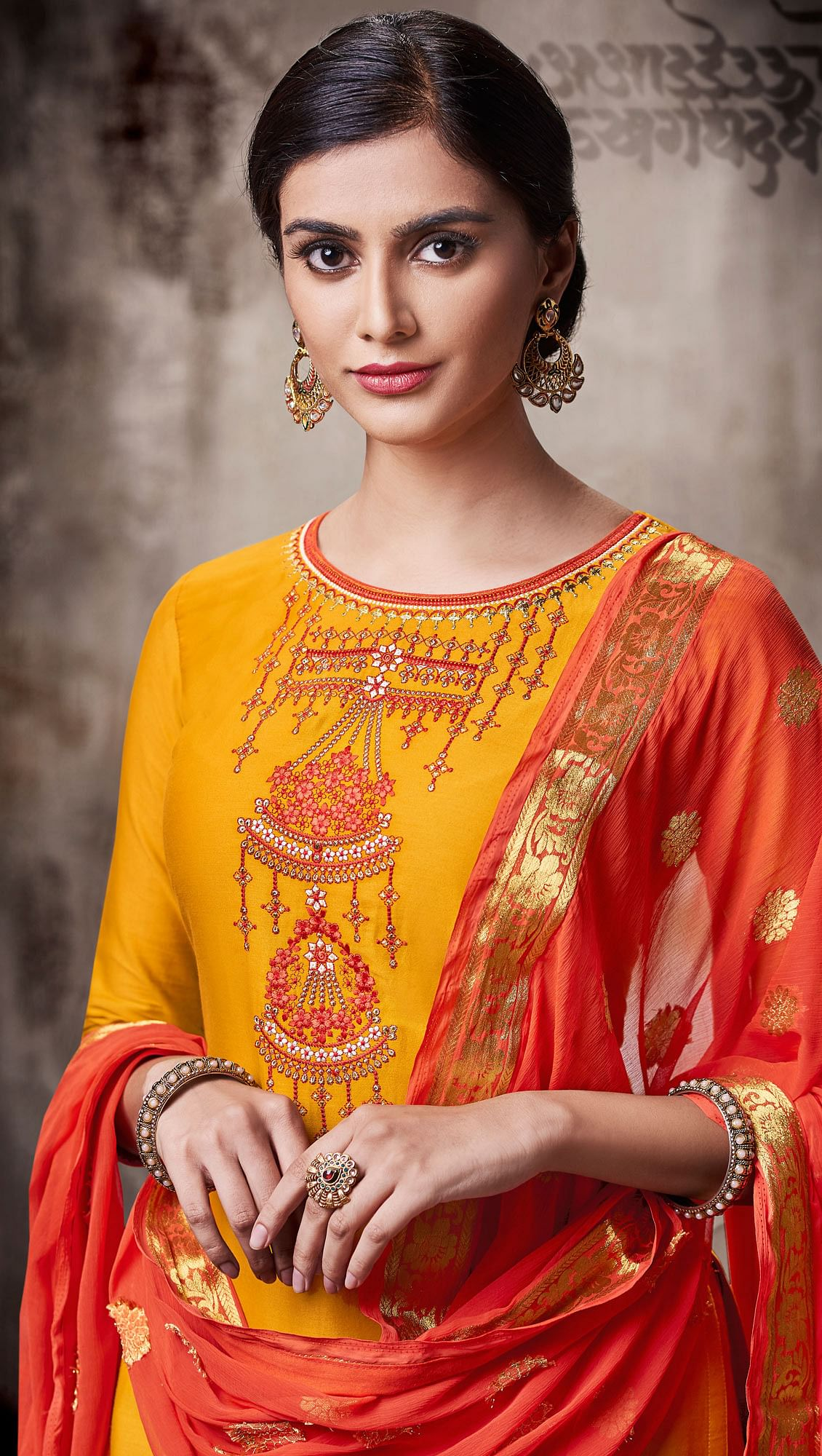 Charming Yellow Colored Embroidered Work Party Wear Silk Cotton Patiala Suit