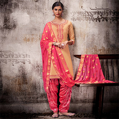 Delightful Beige Colored Embroidered Work Party Wear Silk Cotton Patiala Suit