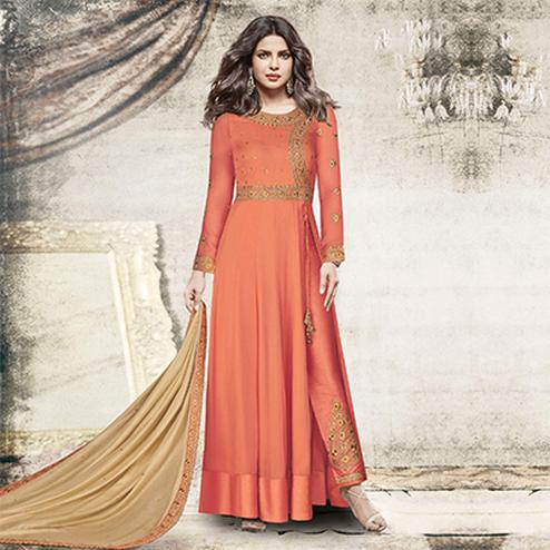 Prominent Peach Colored Designer Embroidered Dyed Georgette Suit