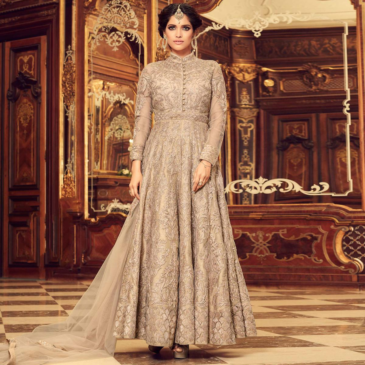 Gleaming Beige Colored Designer Embroidered Party Wear Net Anarkali Suit