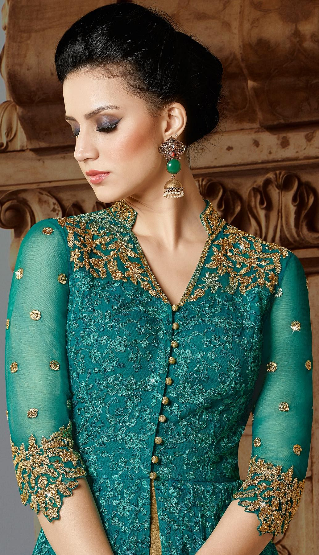 Dazzling Turquoise Designer Embroidered Floor Length Premium Net Suit