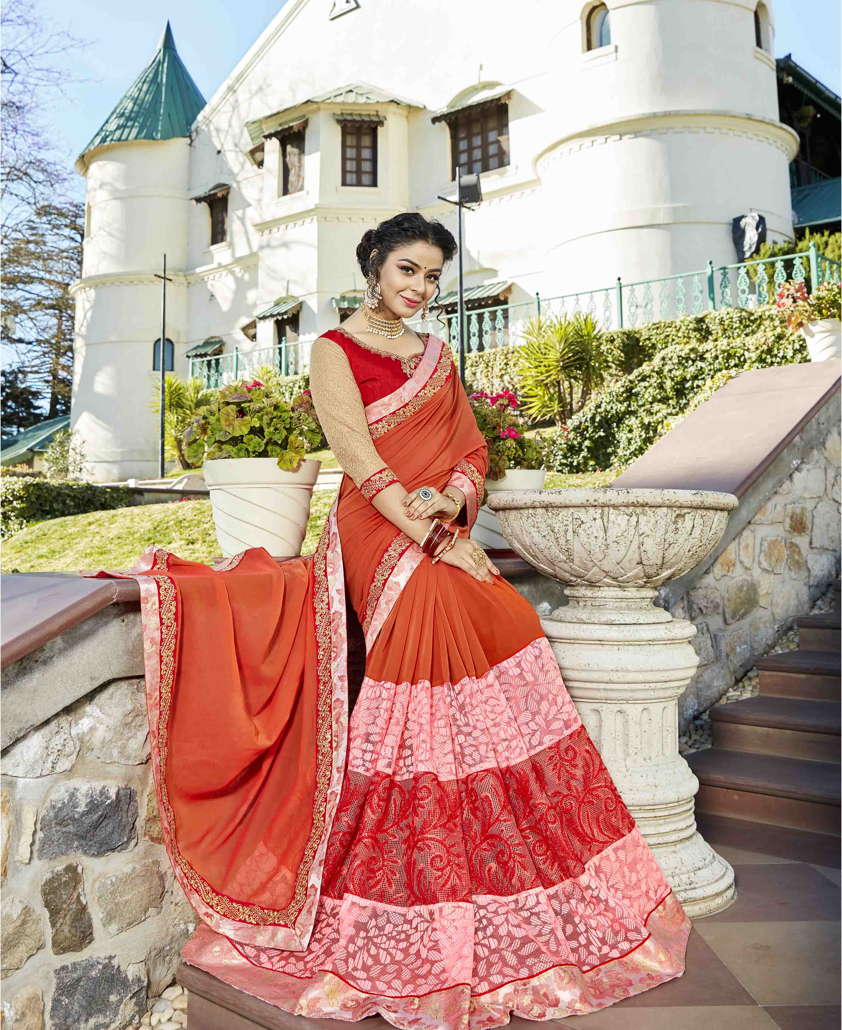 Traditional Orange Colored Partywear Embroidered Art Silk Saree