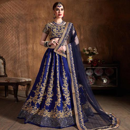 Hypnotic Blue Colored Designer Partywear Raw Silk Lehenga Choli