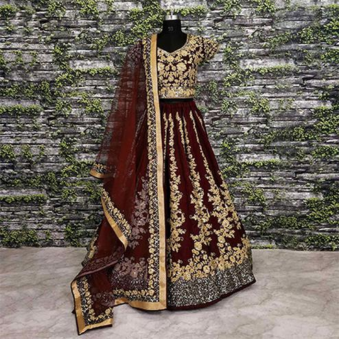Impressive Maroon Colored Designer Partywear Raw Silk Lehenga Choli
