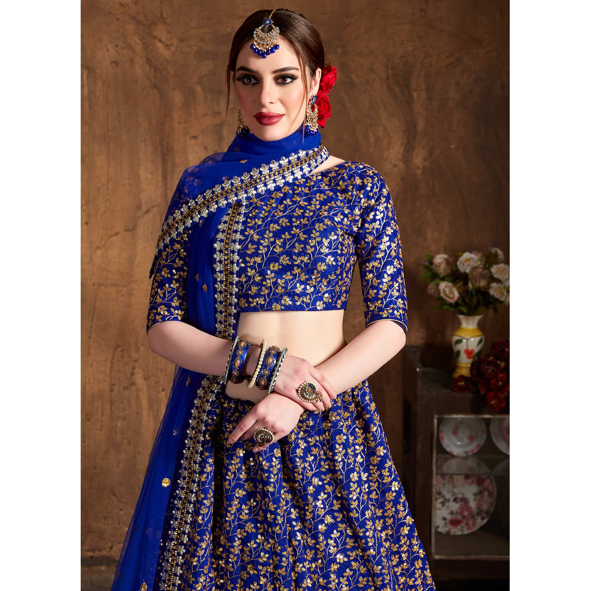 Surpassing Blue Colored Designer Heavy Embroidered Raw Silk Lehenga