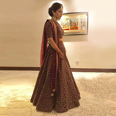 Arresting Maroon Colored Designer Heavy Embroidered Raw Silk Lehenga