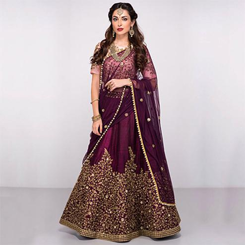 Attractive Purple Colored Partywear Designer Embroidered Silk Lehenga Choli