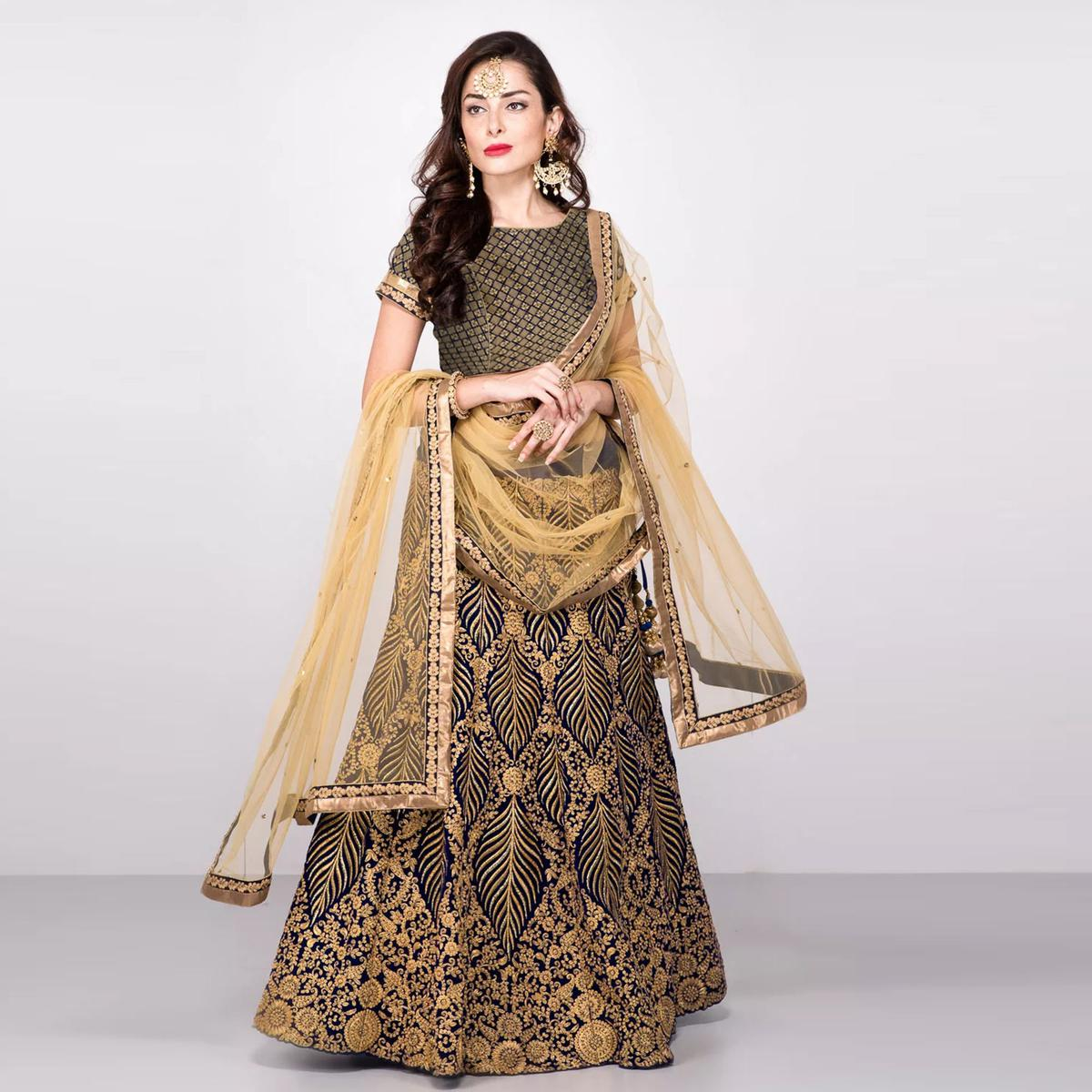 Catchy Blue-Gold Colored Partywear Embroidered Velvet Lehenga Choli