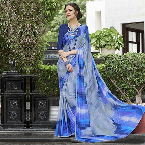 Innovative Grey-Blue Colored Casual Wear Printed Crape Saree