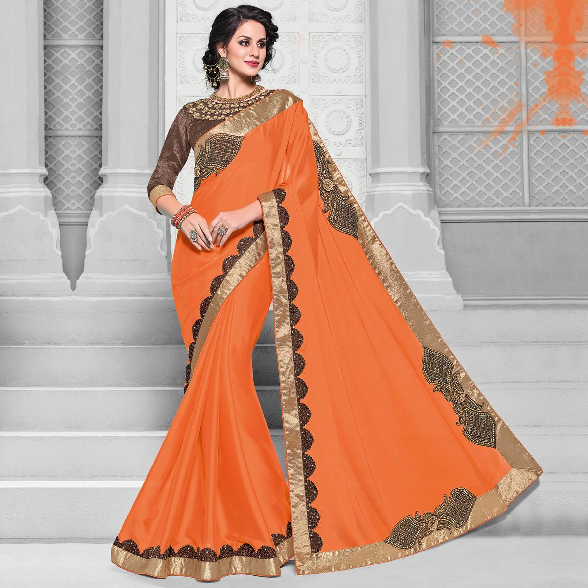 Glorious Orange Colored Designer Embroidered Partywear Georgette Saree