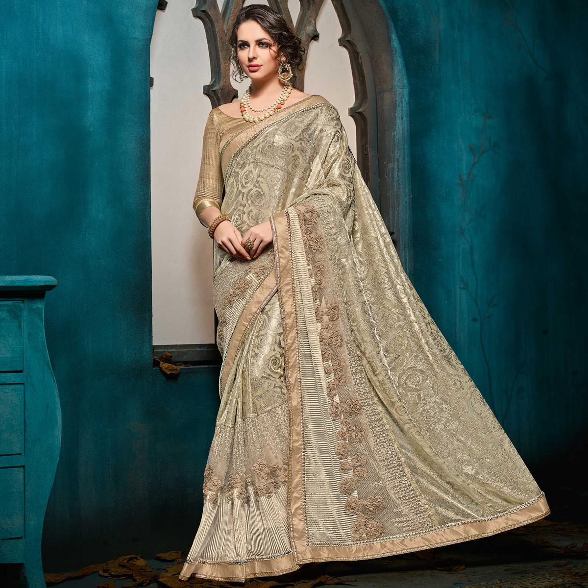 Breathtaking Beige-Gold Colored Designer Party Wear Jacquard Saree