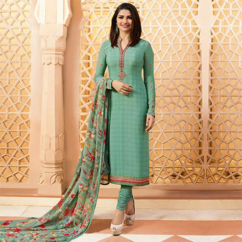 Marvellous Turquoise  Colored Floral Embroidered Work Royal Crepe Suit
