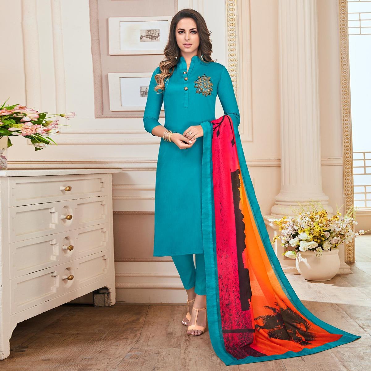 Pleasant Sky Blue Colored Partywear Hand Embroidered Cotton Suit