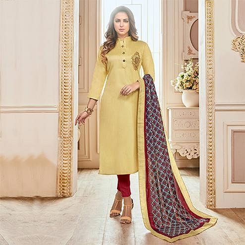 Beautiful Yellow Colored Partywear Hand Embroidered Cotton Suit
