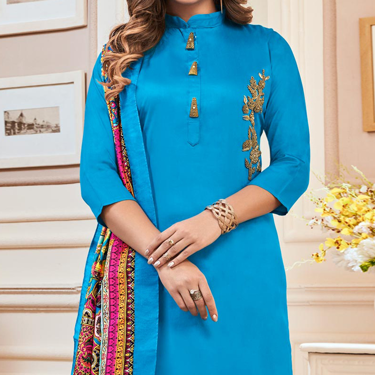 Mesmeric Sky Blue Colored Partywear Hand Embroidered Cotton Suit