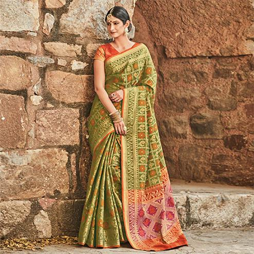 Delightful Olive Green Colored Festive Wear Traditional Pure Patola Silk Saree