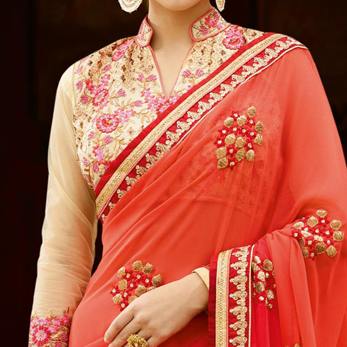 Exceptional Orange Colored Partywear Designer Embroidered Georgette Saree