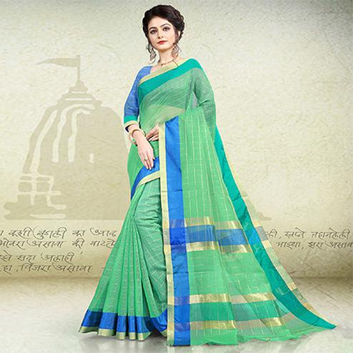 Adorning Light Green Colored Festive Wear Banarasi Cotton Saree