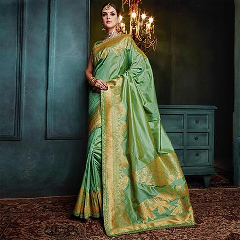 Capricious Green Colored Festive Wear Woven Cotton Silk Jacquard Saree