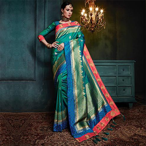 Snazzy Rama Green Colored Festive Wear Woven Cotton Silk Jacquard Saree