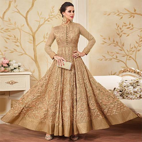 Impressive Beige Colored Partywear Embroidered Net Anarkali Suit