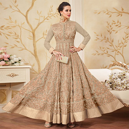 Beautiful Cream Colored Partywear Embroidered Net Anarkali Suit