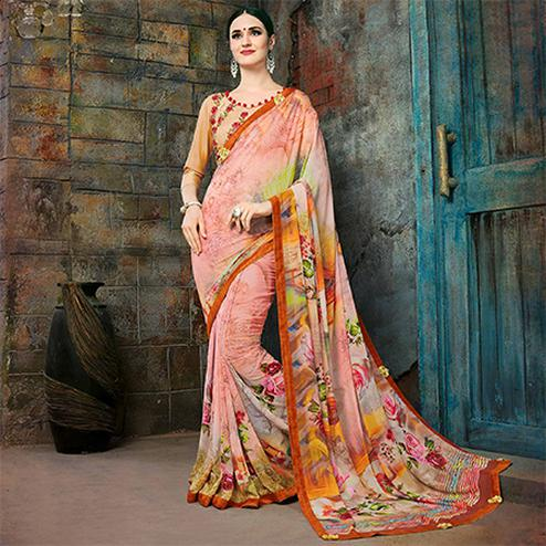Adorning Peach Colored Casual Printed Georgette Saree