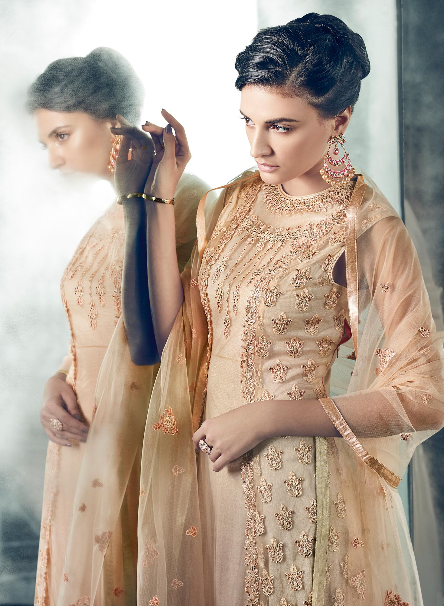 Arresting Peach Colored Partywear Designer Embroidered Net Anarkali Suit